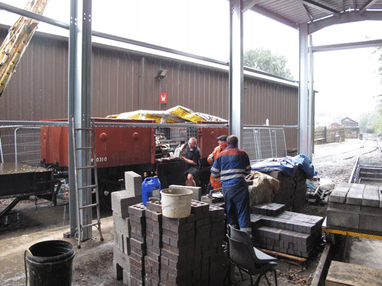 bricks being unloaded from a wagon
